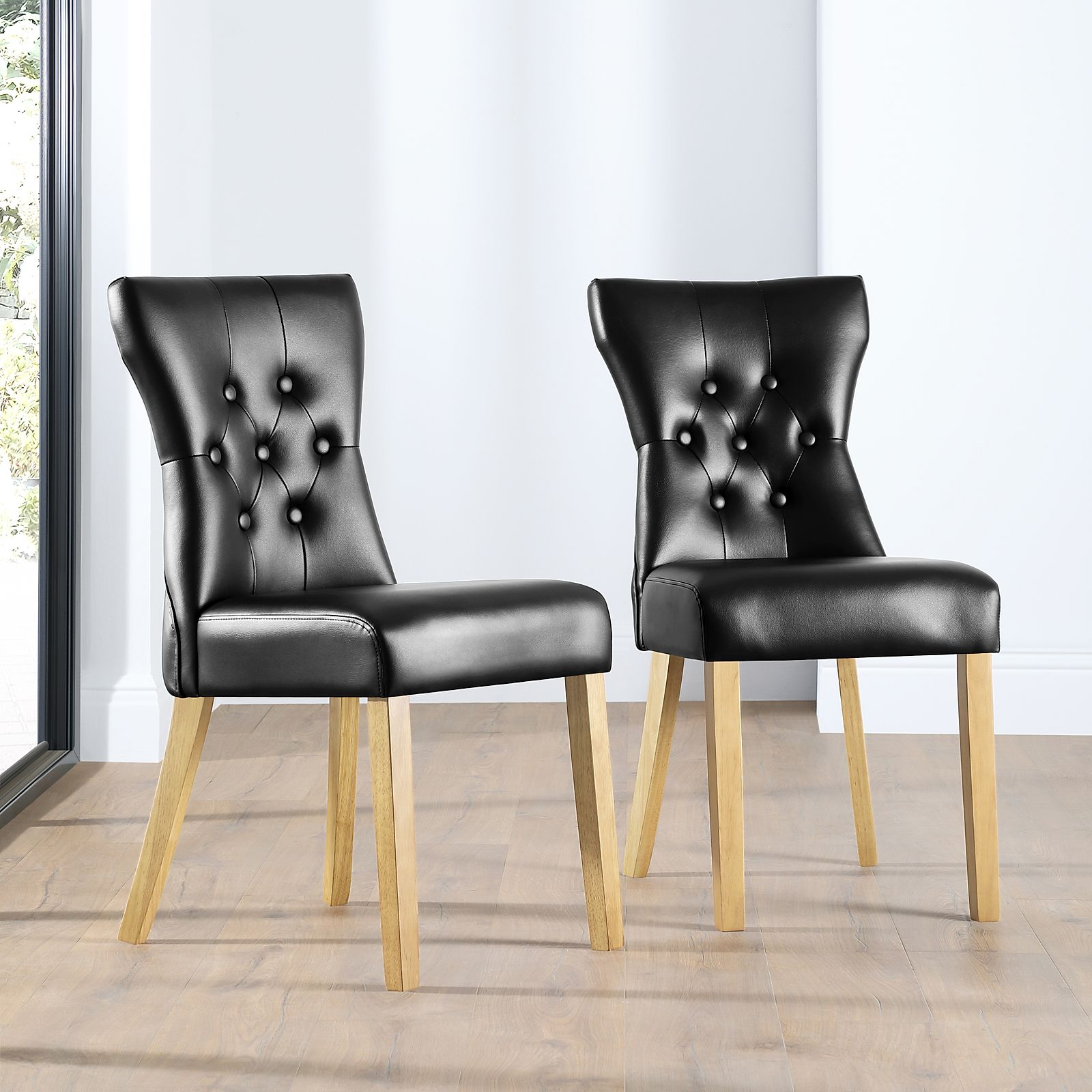 Bewley Black Leather Button Back Dining Chair Oak Leg