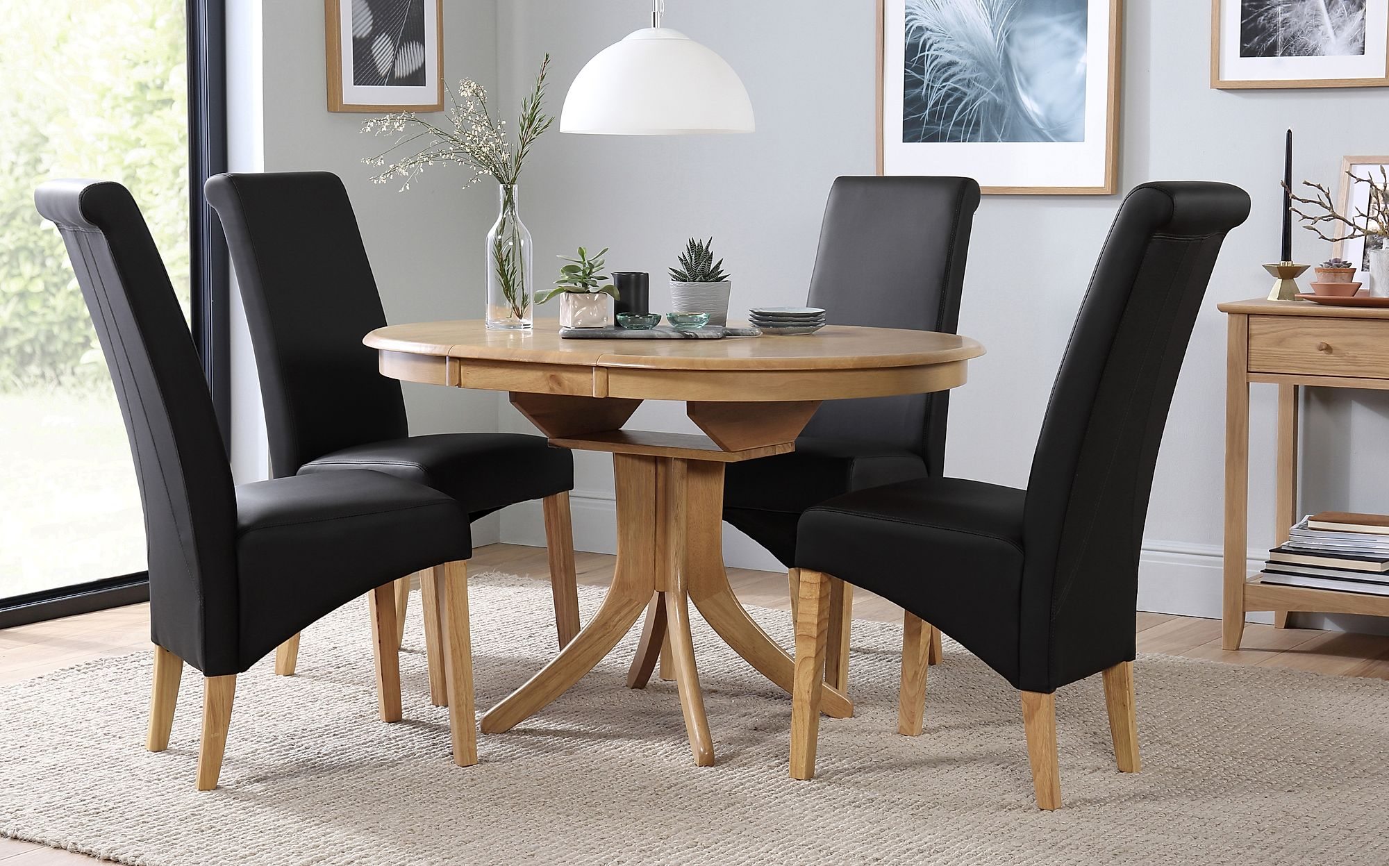 hudson round oak extending dining table with 6 richmond black chairs only furniture choice. Black Bedroom Furniture Sets. Home Design Ideas