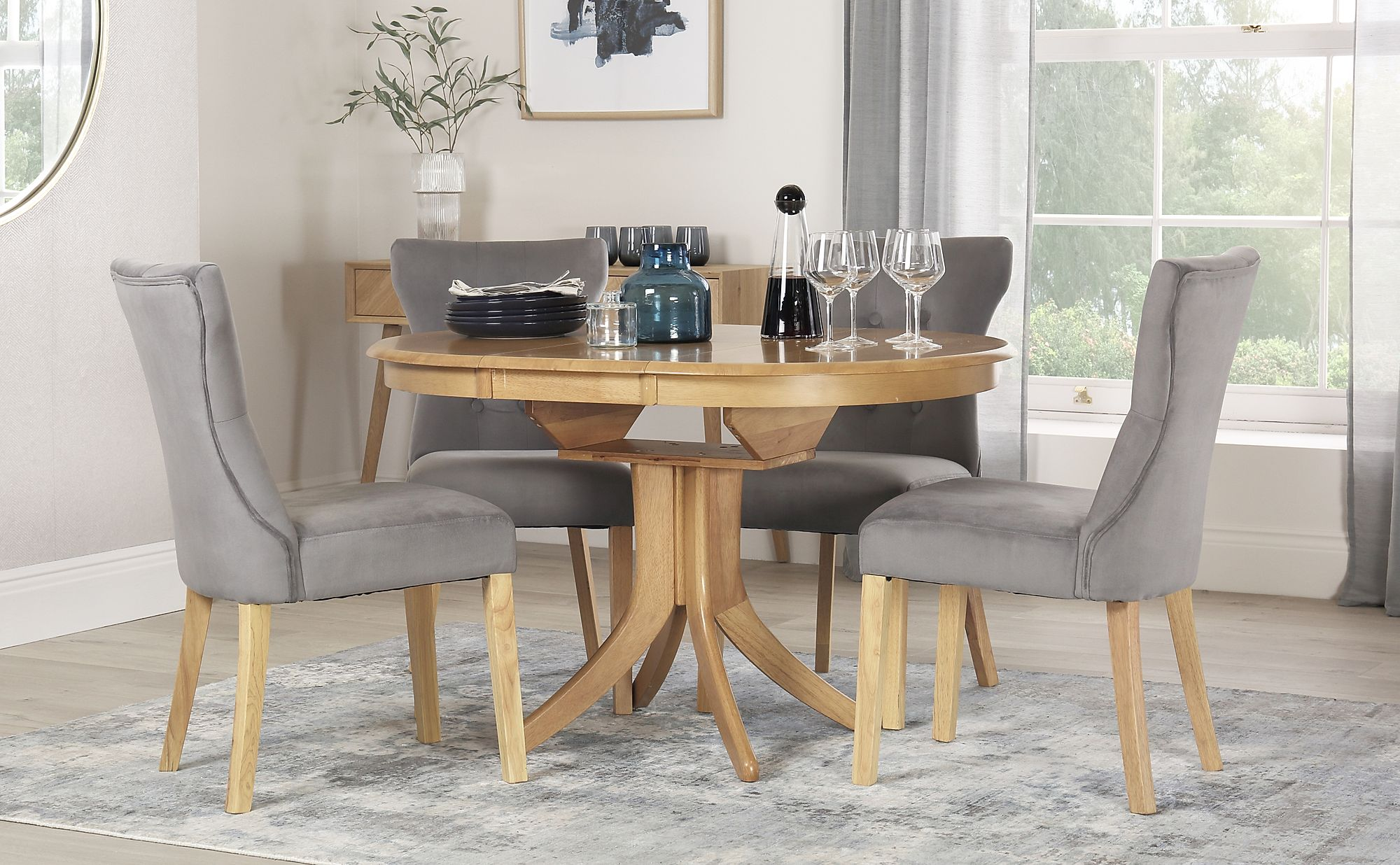 Picture of: Hudson Round Oak Extending Dining Table With 4 Bewley Grey Velvet Chairs Furniture Choice