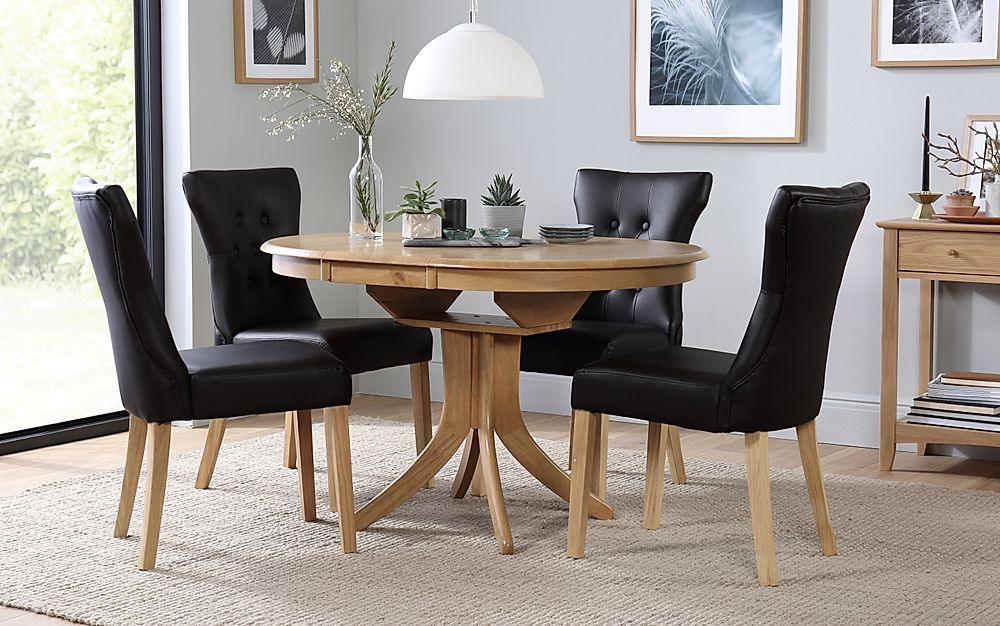 Hudson Round Oak Extending Dining Table with 6 Bewley Black Leather Chairs
