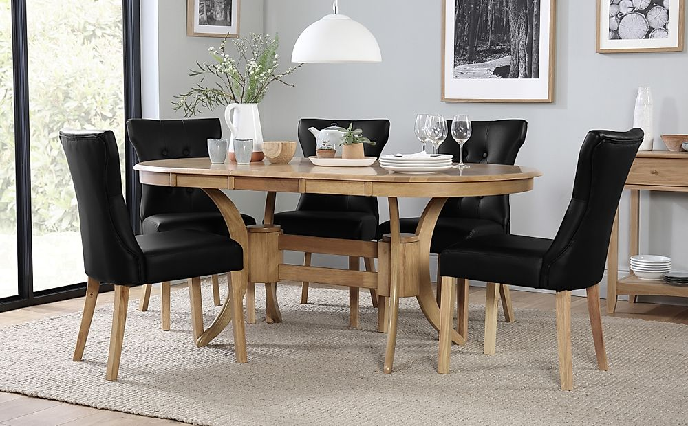 Townhouse Oval Oak Extending Dining Table with 4 Bewley Black Leather Chairs