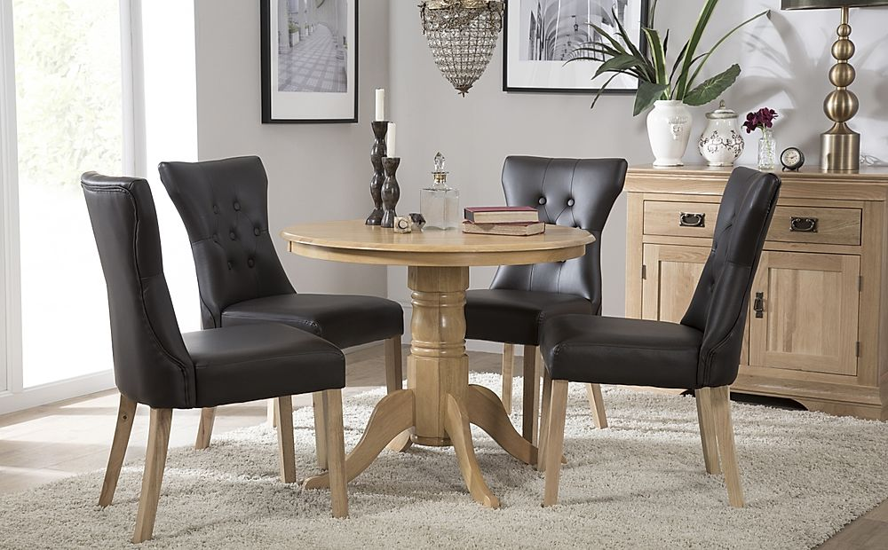 Kingston Round Oak Dining Table with 4 Bewley Black Chairs
