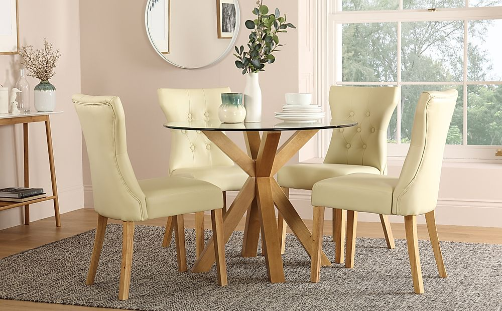 Hatton Round Oak and Glass Dining Table with 4 Bewley Ivory Chairs