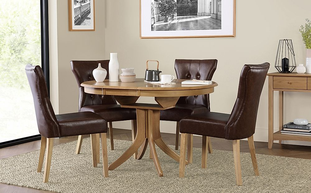 Hudson Round Oak Extending Dining Table with 6 Bewley Club Brown Chairs
