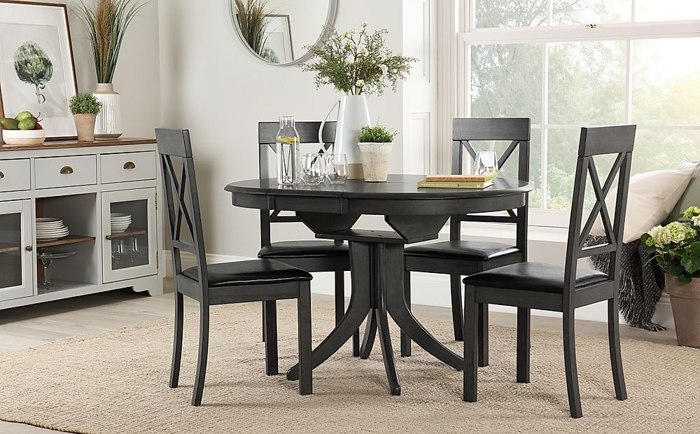 Hudson Round Grey Wood Extending Dining Table with 6 Kendal Chairs (Black Seat Pad)