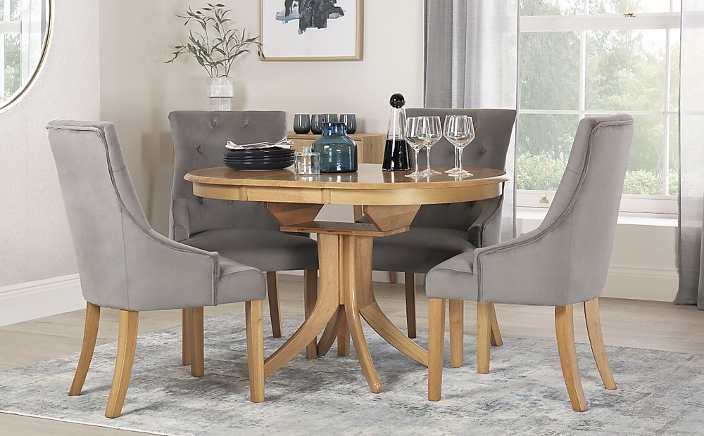 Hudson Round Oak Extending Dining Table with 4 Duke Grey Velvet Chairs