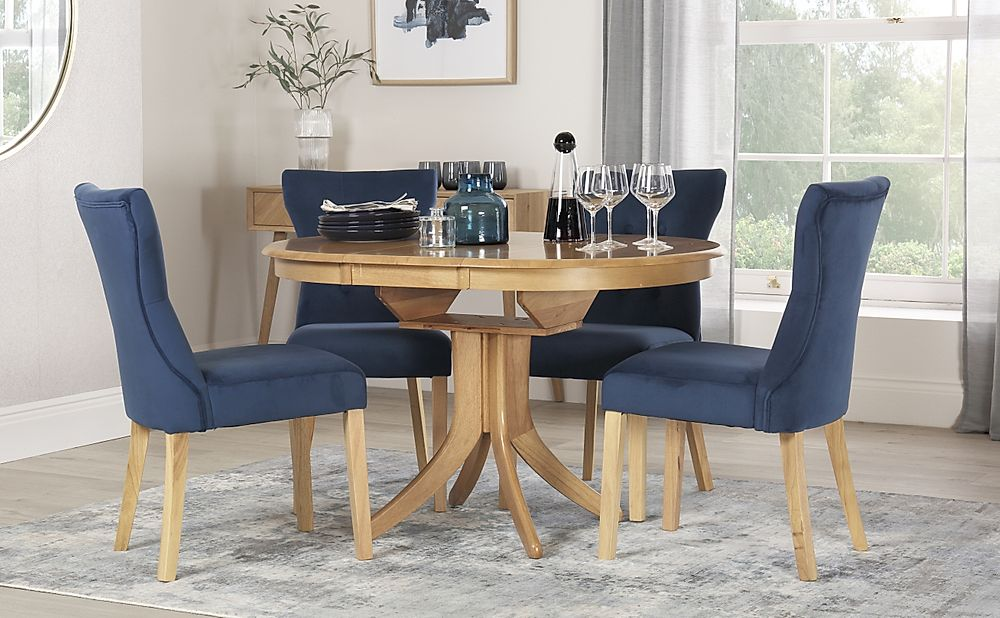 Hudson Round Oak Extending Dining Table with 6 Bewley Blue Velvet Chairs