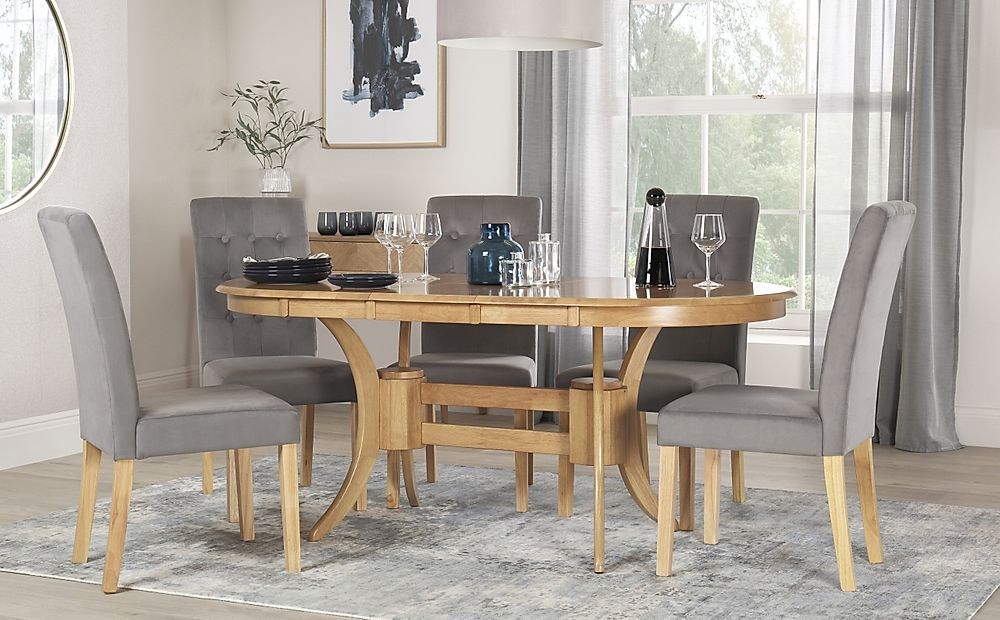 Townhouse Oval Oak Extending Dining Table with 6 Regent Grey Velvet Chairs
