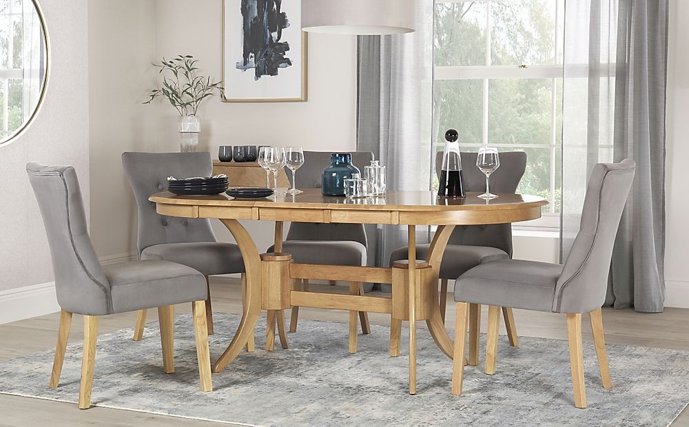 Townhouse Oval Oak Extending Dining Table with 6 Bewley Grey Velvet Chairs