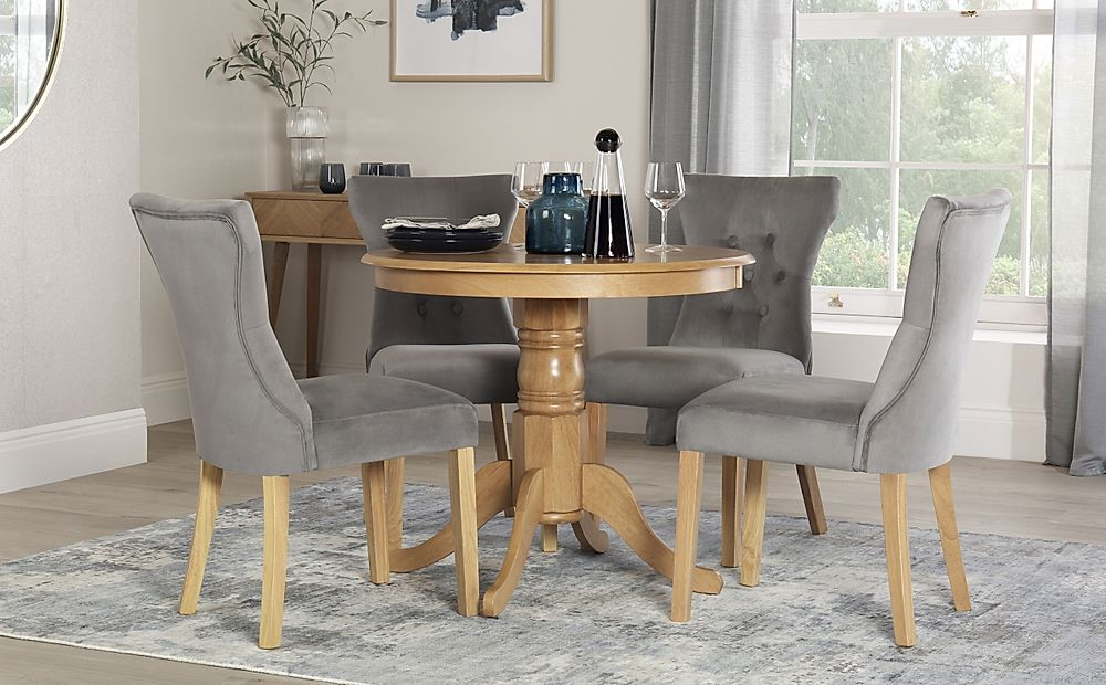 Kingston Round Oak Dining Table with 4 Bewley Grey Velvet Chairs