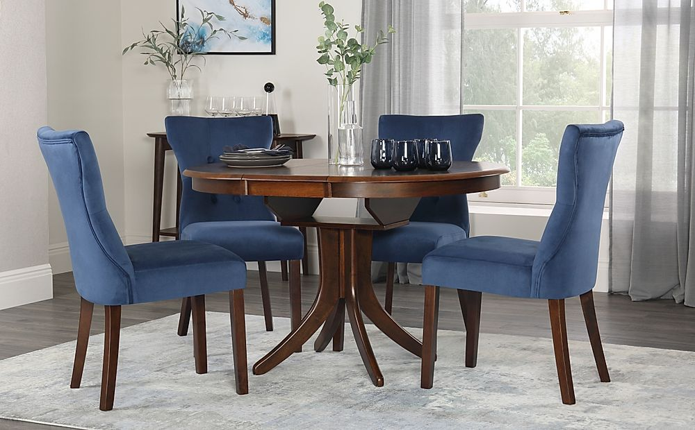 Hudson Round Walnut Extending Dining Table with 6 Bewley Blue Velvet Chairs