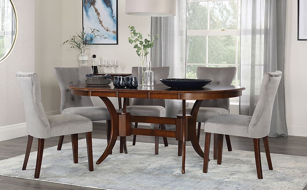 Townhouse Oval Walnut Extending Dining Table with 4 Bewley Grey Velvet Chairs