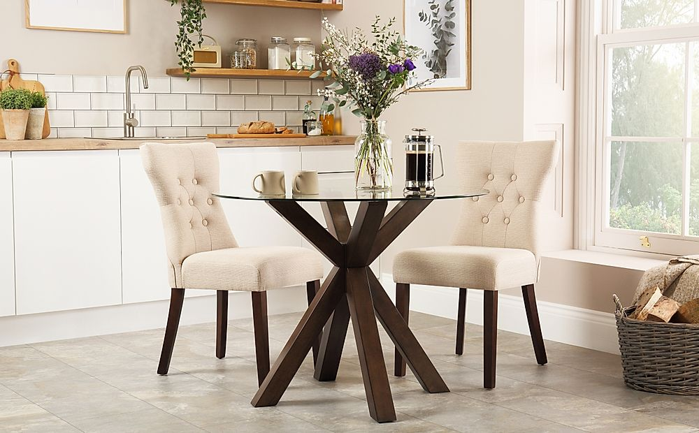 Hatton Round Dark Wood and Glass Dining Table with 2 Bewley Oatmeal Fabric Chairs
