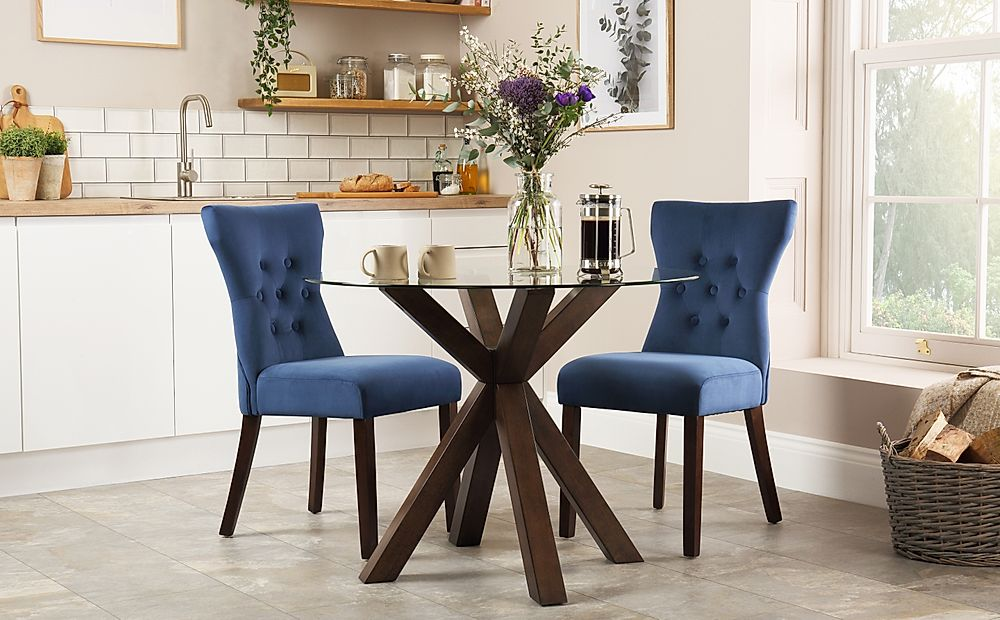 Hatton Round Walnut and Glass Dining Table with 2 Bewley Blue Velvet Chairs