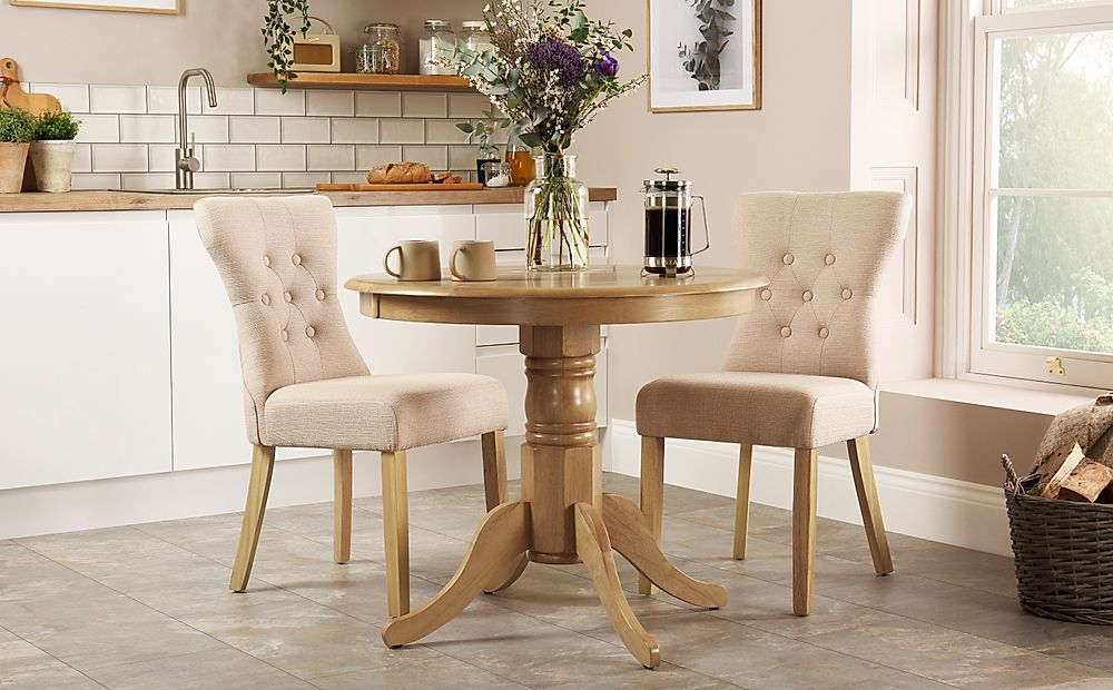Kingston Round Oak Dining Table with 2 Bewley Oatmeal Fabric Chairs