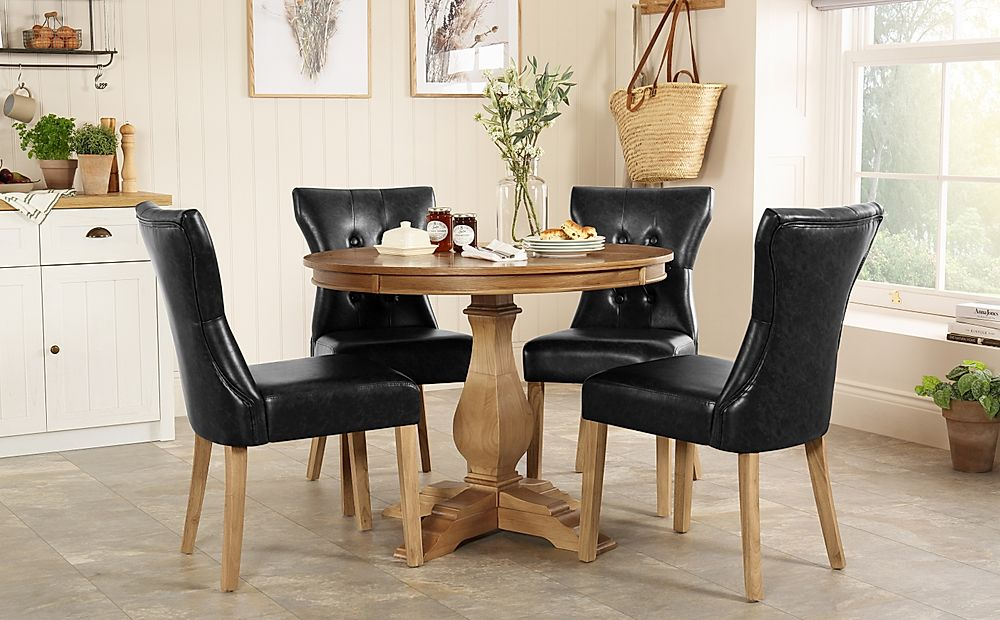 Cavendish Round Oak Dining Table with 4 Bewley Black Leather Chairs