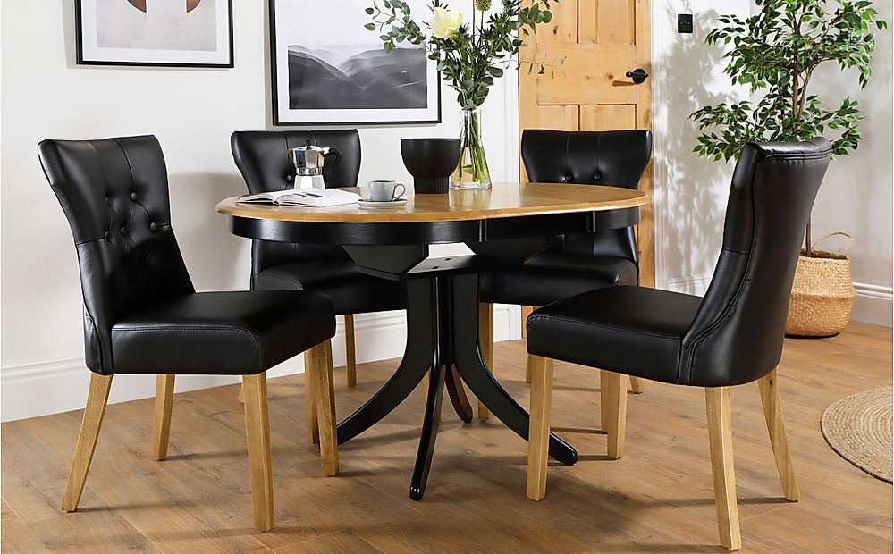 Hudson Round Painted Black and Oak Extending Dining Table with 4 Bewley Black Leather Chairs (Oak Le