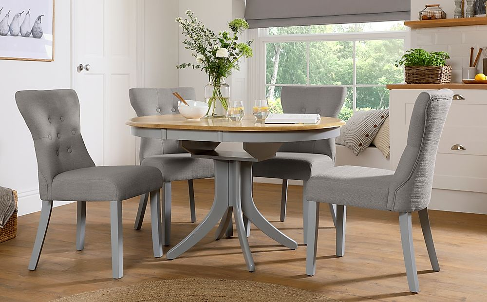 Hudson Round Painted Grey and Oak Extending Dining Table with 6 Bewley Light Grey Fabric Chairs