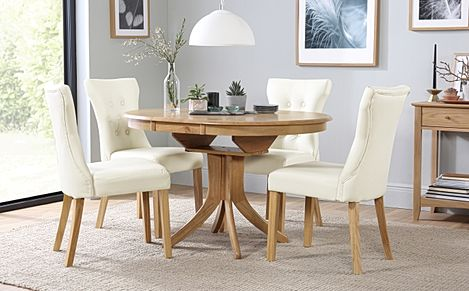 Hudson Round Oak Extending Dining Table with 6 Bewley Ivory Leather Chairs