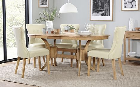 Townhouse Oval Oak Extending Dining Table with 6 Bewley Ivory Leather Chairs