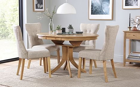 Hudson Round Oak Extending Dining Table with 6 Bewley Oatmeal Fabric Chairs