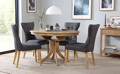 Hudson Round Oak Extending Dining Table with 6 Bewley Slate Fabric Chairs