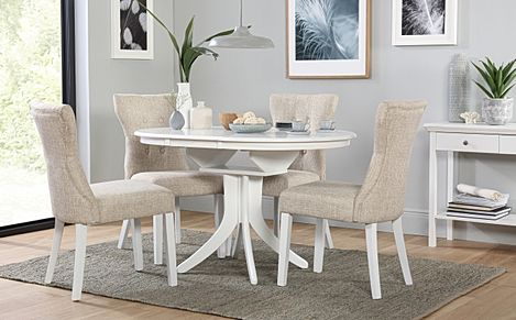 Hudson Round White Extending Dining Table with 6 Bewley Oatmeal Fabric Chairs