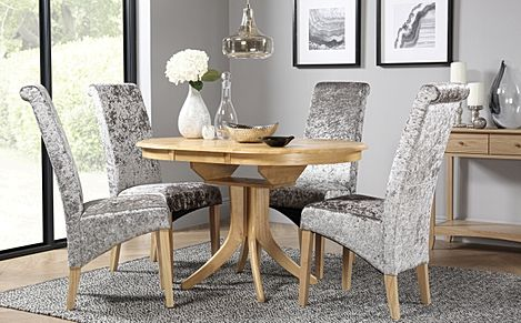 Hudson Round Oak Extending Dining Room Table with 6 Boston Silver Velvet Chairs