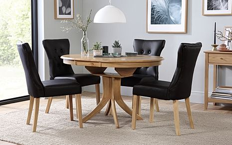 Hudson Round Oak Extending Dining Table with 4 Bewley Black Leather Chairs