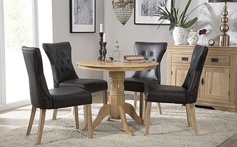 Kingston Round Oak Dining Table with 4 Bewley Black Leather Chairs