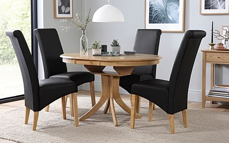 Hudson Round Oak Extending Dining Table with 6 Richmond Black Leather Chairs