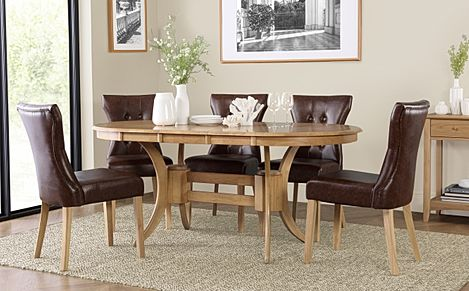 Townhouse Oval Oak Extending Dining Table with 6 Bewley Club Brown Leather Chairs