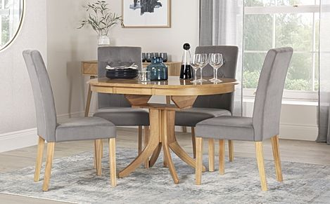Hudson Round Oak Extending Dining Table with 4 Regent Grey Velvet Chairs
