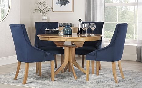 Hudson Round Oak Extending Dining Table with 4 Duke Blue Velvet Chairs
