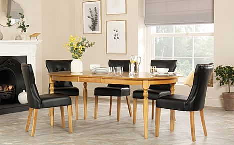 Albany Oval Oak Extending Dining Table with 8 Bewley Black Chairs
