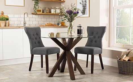 Hatton Round Dark Wood and Glass Dining Table with 2 Bewley Slate Fabric Chairs