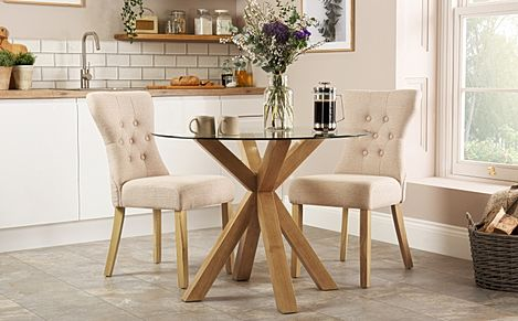 Hatton Round Oak and Glass Dining Table with 2 Bewley Oatmeal Fabric Chairs