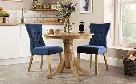 Kingston Round Oak Dining Table with 2 Bewley Blue Velvet Chairs