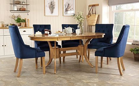 Townhouse Oval Oak Extending Dining Table with 4 Duke Blue Velvet Chairs