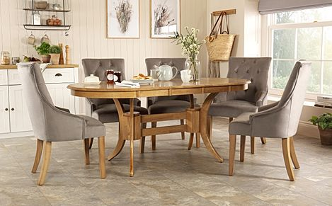 Townhouse Oval Oak Extending Dining Table with 6 Duke Grey Velvet Chairs