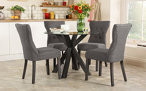 Hatton Round Grey Wood and Glass Dining Table with 4 Bewley Slate Fabric Chairs