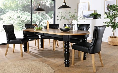 Manor Oval Painted Black and Oak Extending Dining Table with 6 Bewley Black Leather Chairs