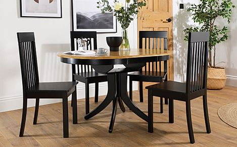 Hudson Round Painted Black and Oak Extending Dining Table with 4 Oxford Black Chairs