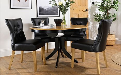 Hudson Round Painted Black and Oak Extending Dining Table with 6 Bewley Black Leather Chairs (Oak Le