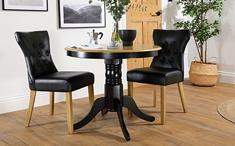 Kingston Round Painted Black and Oak Dining Table with 2 Bewley Black Leather Chairs
