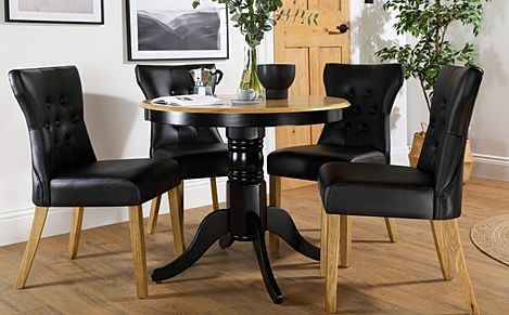 Kingston Round Painted Black and Oak Dining Table with 4 Bewley Black Leather Chairs
