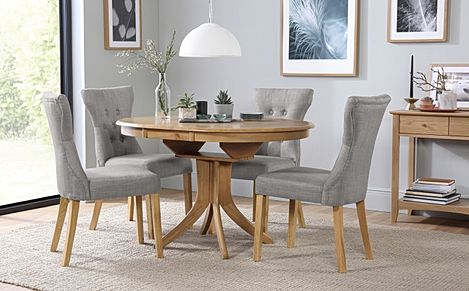 Hudson Round Oak Extending Dining Table with 6 Bewley Light Grey Fabric Chairs