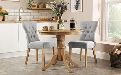 Kingston Round Oak Dining Table with 2 Bewley Light Grey Fabric Chairs
