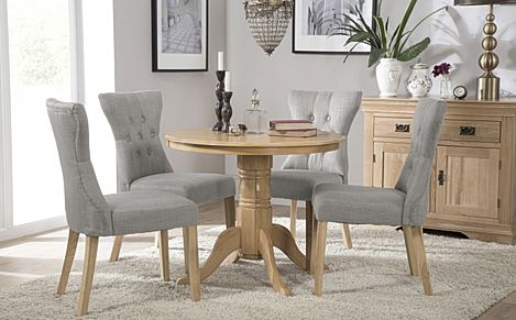 Kingston Round Oak Dining Table with 4 Bewley Light Grey Fabric Chairs