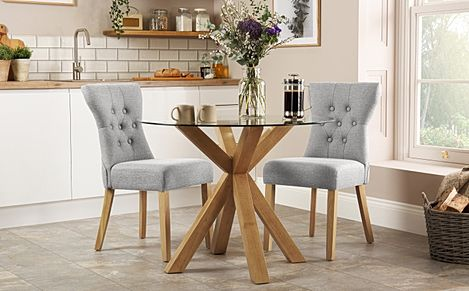 Hatton Round Oak and Glass Dining Table with 2 Bewley Light Grey Fabric Chairs
